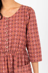 The Vivid Check Tiered Maxi Dress in Mauve, studio shoot; closer up front view