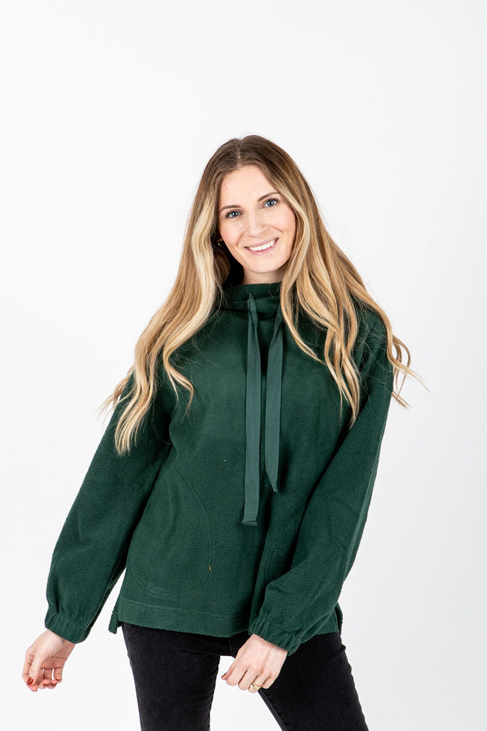 The Suzanne Fleece Hooded Pullover in Hunter Green, studio shoot; front view