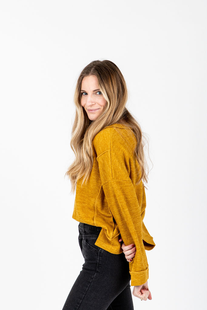 The Winstone Casual V-Neck Sweater in Mustard, studio shoot; side view