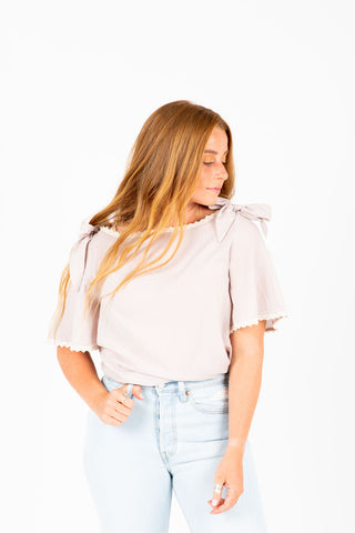 The Ari Button Ruffle Blouse in Blush