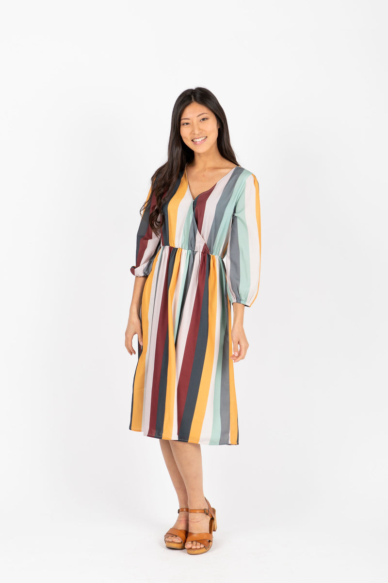 The Tippi Striped Wrap Dress in Multi, studio shoot; front view