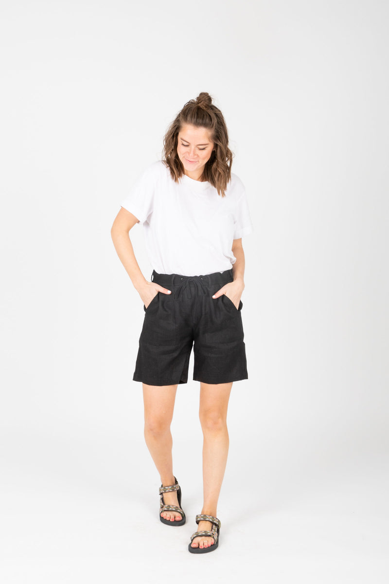 The Parker Linen Bermuda Shorts in Black, studio shoot; front view