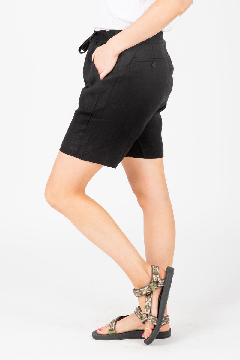 The Parker Linen Bermuda Shorts in Black, studio shoot; side view