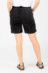 The Parker Linen Bermuda Shorts in Black, studio shoot; back view