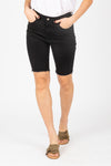 The Stretch Denim Biker Short in Black, studio shoot; front view