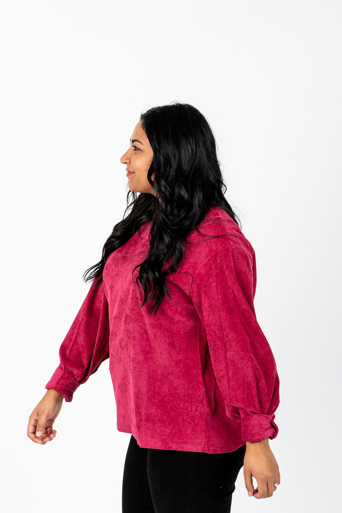 The Shana Corduroy Blouse in Ruby, studio shoot; side view