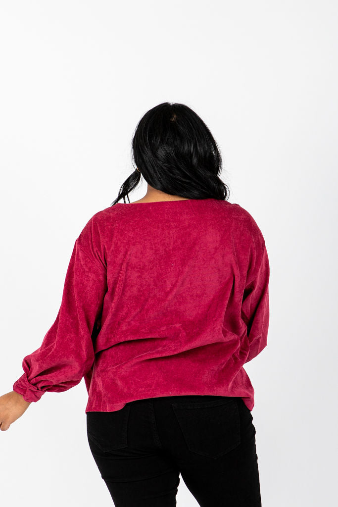The Shana Corduroy Blouse in Ruby, studio shoot; back view