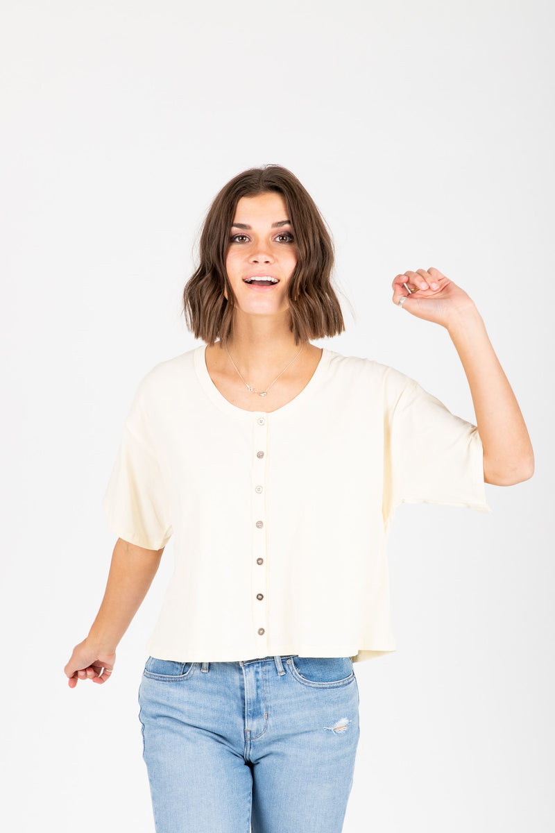 The Jay Button Tee in Cream, studio shoot; front view