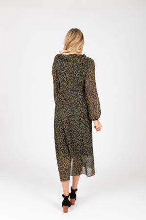 The Ruth Patterned Wrap Dress in Navy, studio shoot; back view