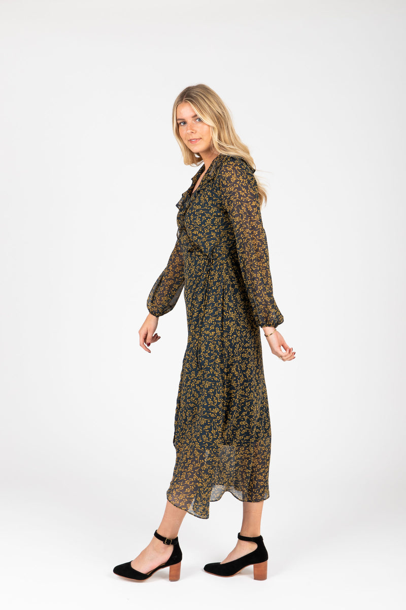 The Ruth Patterned Wrap Dress in Navy, studio shoot; side view