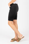 The Stretch Denim Biker Short in Black, studio shoot; side view