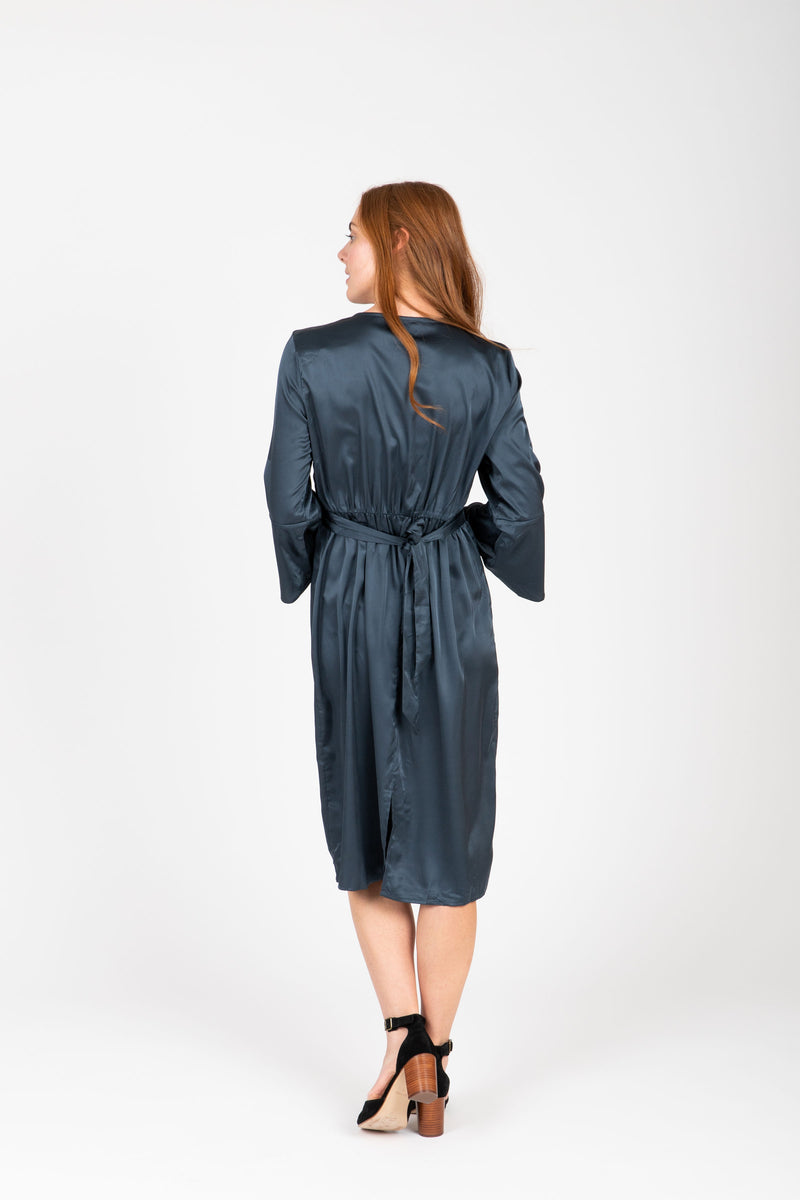 The Tull Satin Flare Sleeve Dress in Stone, studio shoot; back view