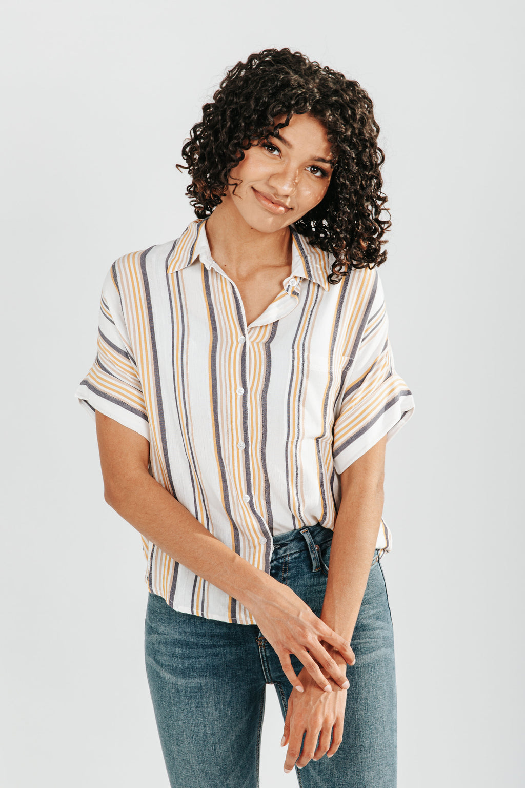 The Elena Stripe Button Down Blouse in Ivory, studio shoot; front view