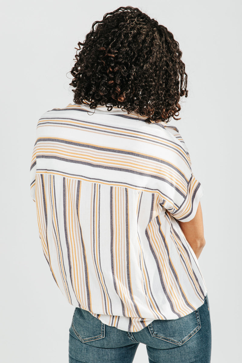 The Elena Stripe Button Down Blouse in Ivory, studio shoot; back view