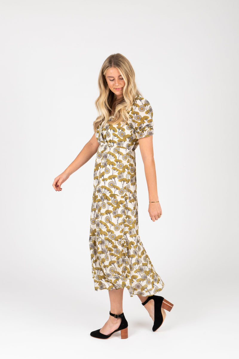 The Jackman Floral Tiered Dress in Cream, studio shoot; side view