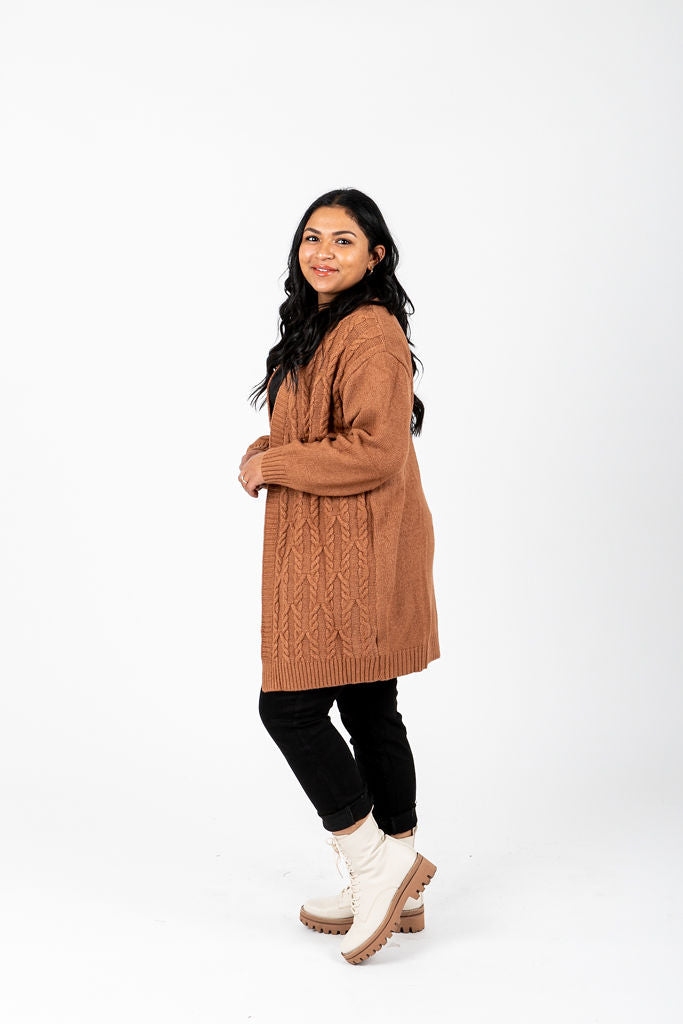 The Swinton Cable Knit Cardigan in Camel, studio shoot; side view