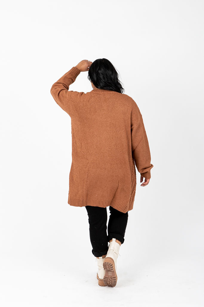The Swinton Cable Knit Cardigan in Camel, studio shoot; back view