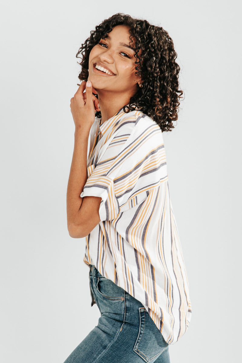 The Elena Stripe Button Down Blouse in Ivory, studio shoot; side view