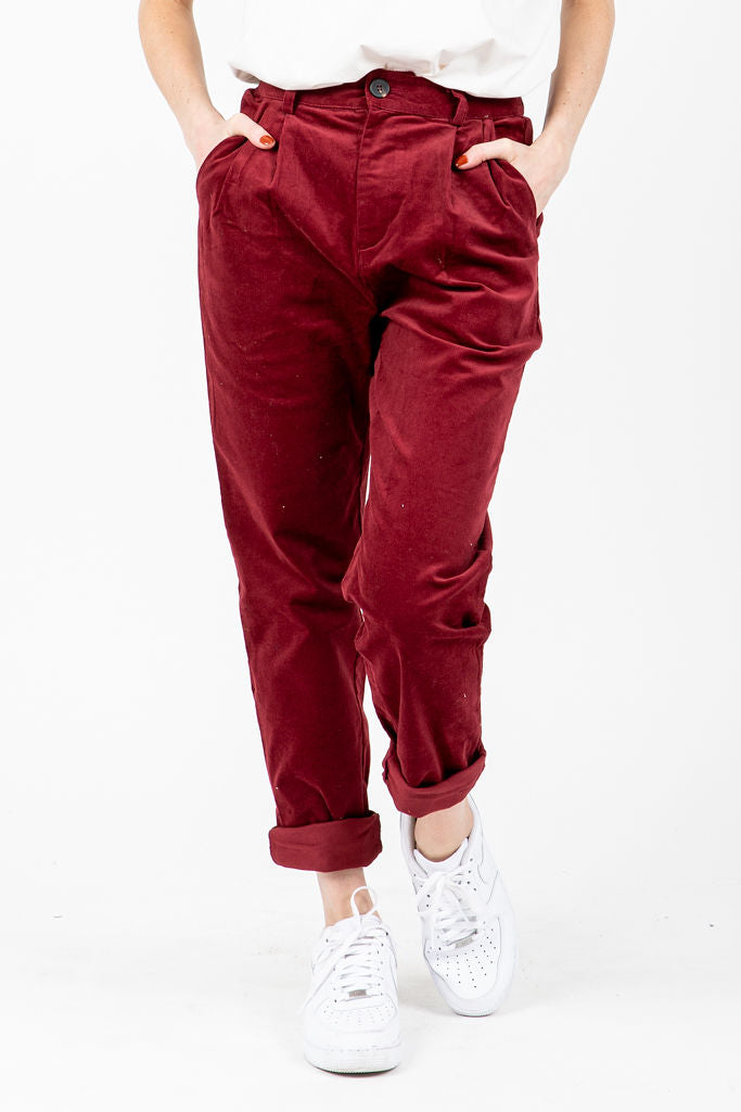 The Draper Pleated Velvet Trousers in Ruby, studio shoot; front view