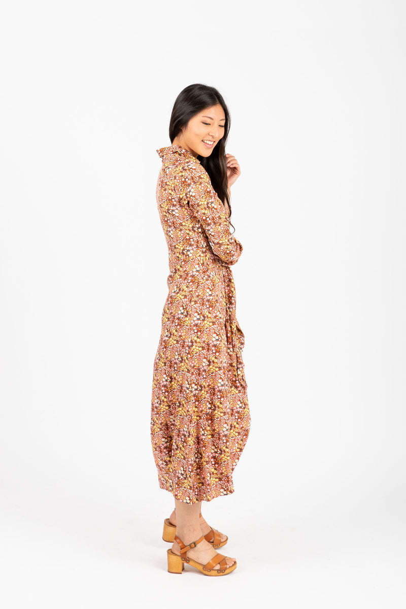 The Darrow Floral Collared Tie Front Dress in Rust, studio shoot; side view