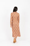 The Darrow Floral Collared Tie Front Dress in Rust, studio shoot; back view