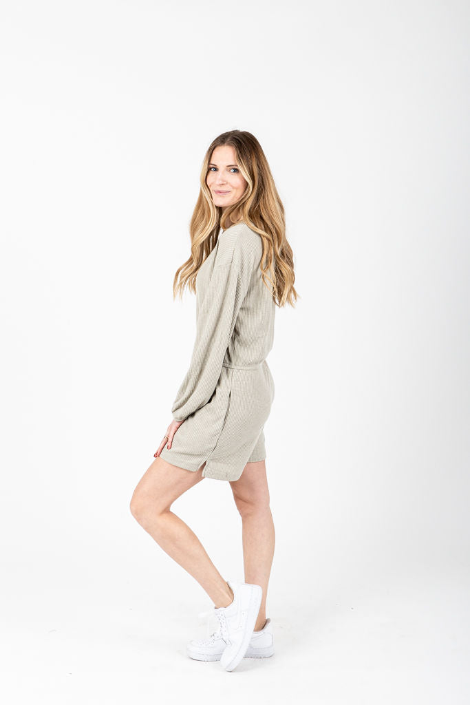 The Keynes Ribbed Casual Romper in Pale Olive, studio shoot; side view