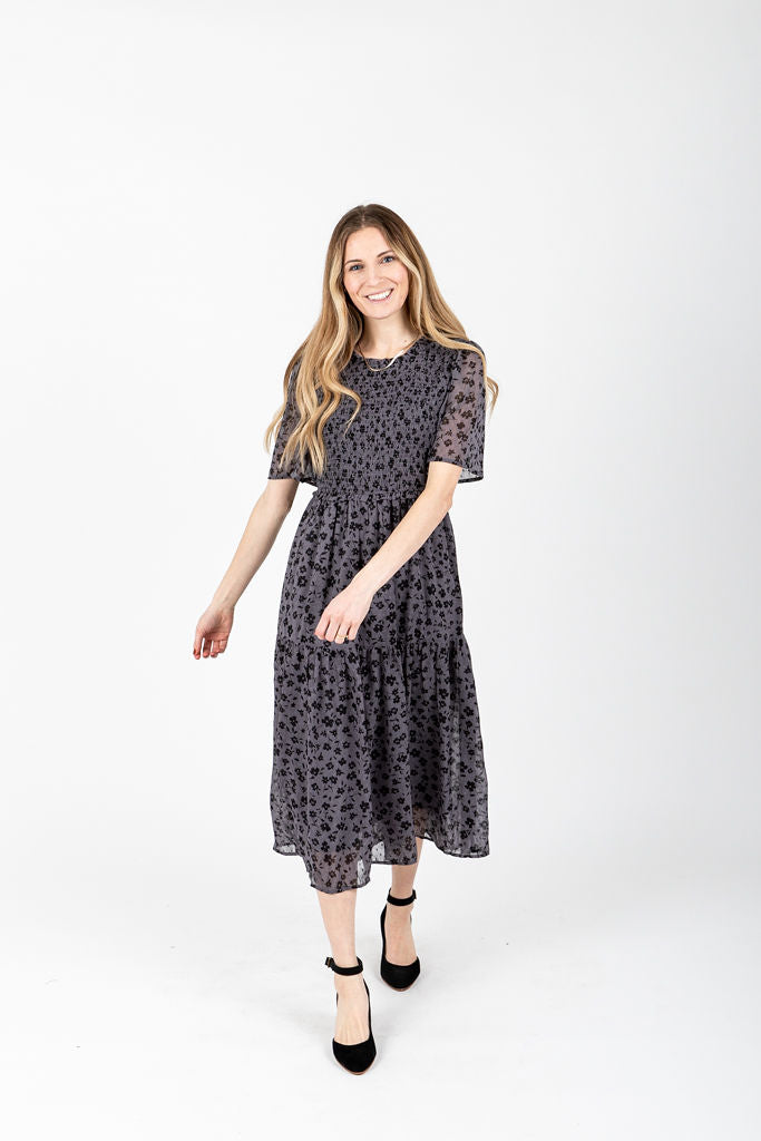 The Dawson Floral Smocked Dress in Dusty Grey, studio shoot; front view