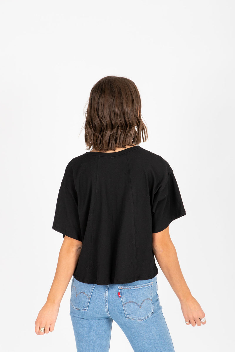 The Jay Button Tee in Black, studio shoot; back view