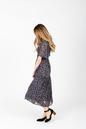 The Dawson Floral Smocked Dress in Dusty Grey, studio shoot; side view