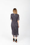 The Dawson Floral Smocked Dress in Dusty Grey, studio shoot; back view