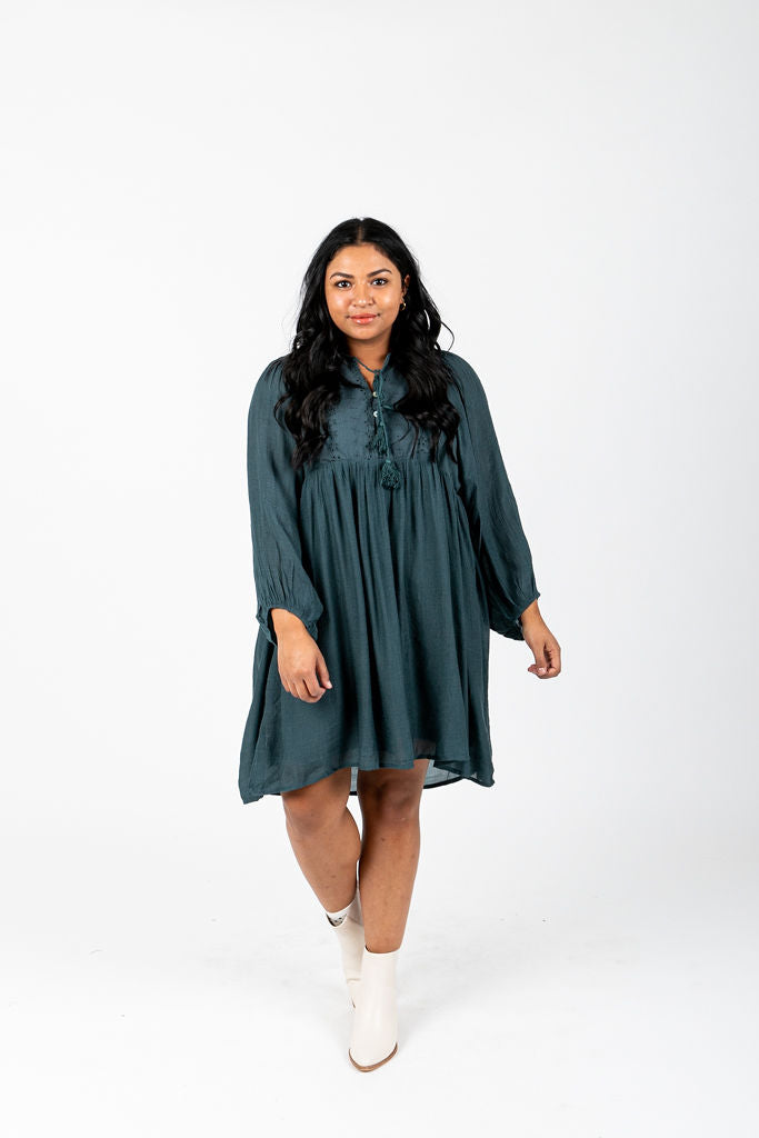 The Ruthie Button Tassel Dress in Teal, studio shoot; front view