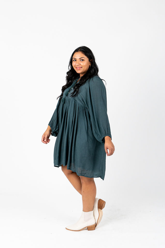 The Ruthie Button Tassel Dress in Teal, studio shoot; side view