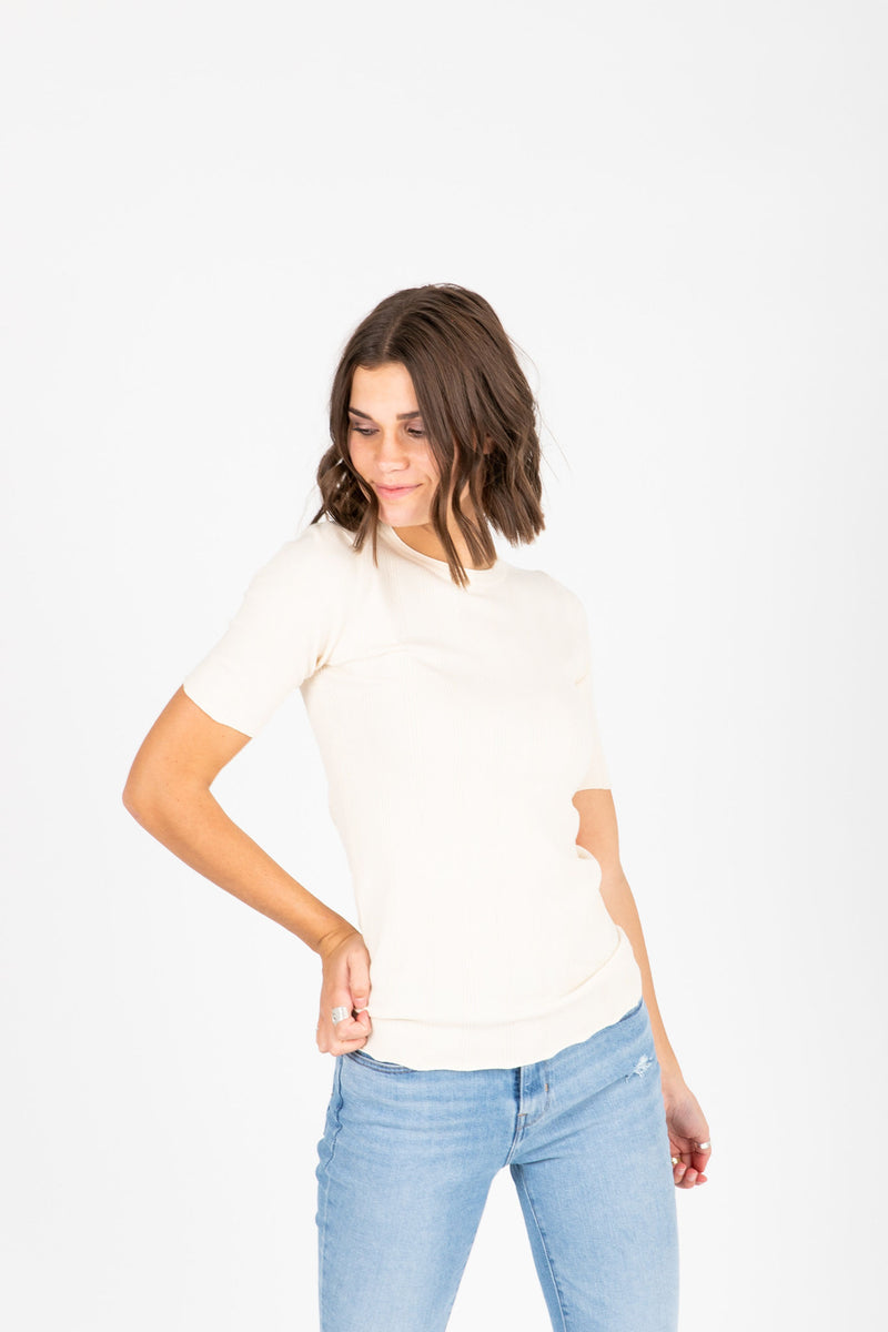 The Becca Knit Blouse in Cream, studio shoot; front view