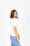 The Becca Knit Blouse in Cream, studio shoot; side view