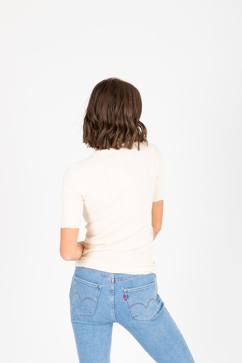 The Becca Knit Blouse in Cream, studio shoot; back view