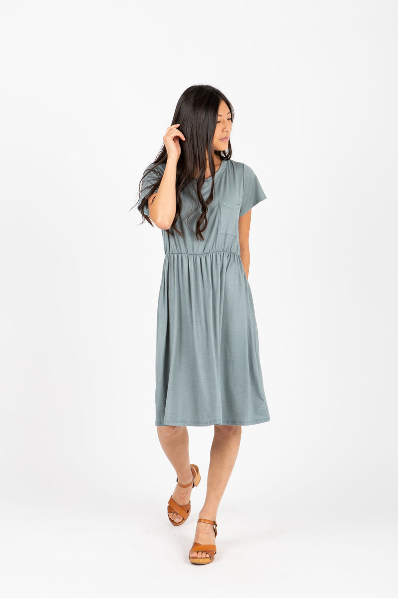 The Madeleine Casual Empire Dress in Sage- studio shoot; front view