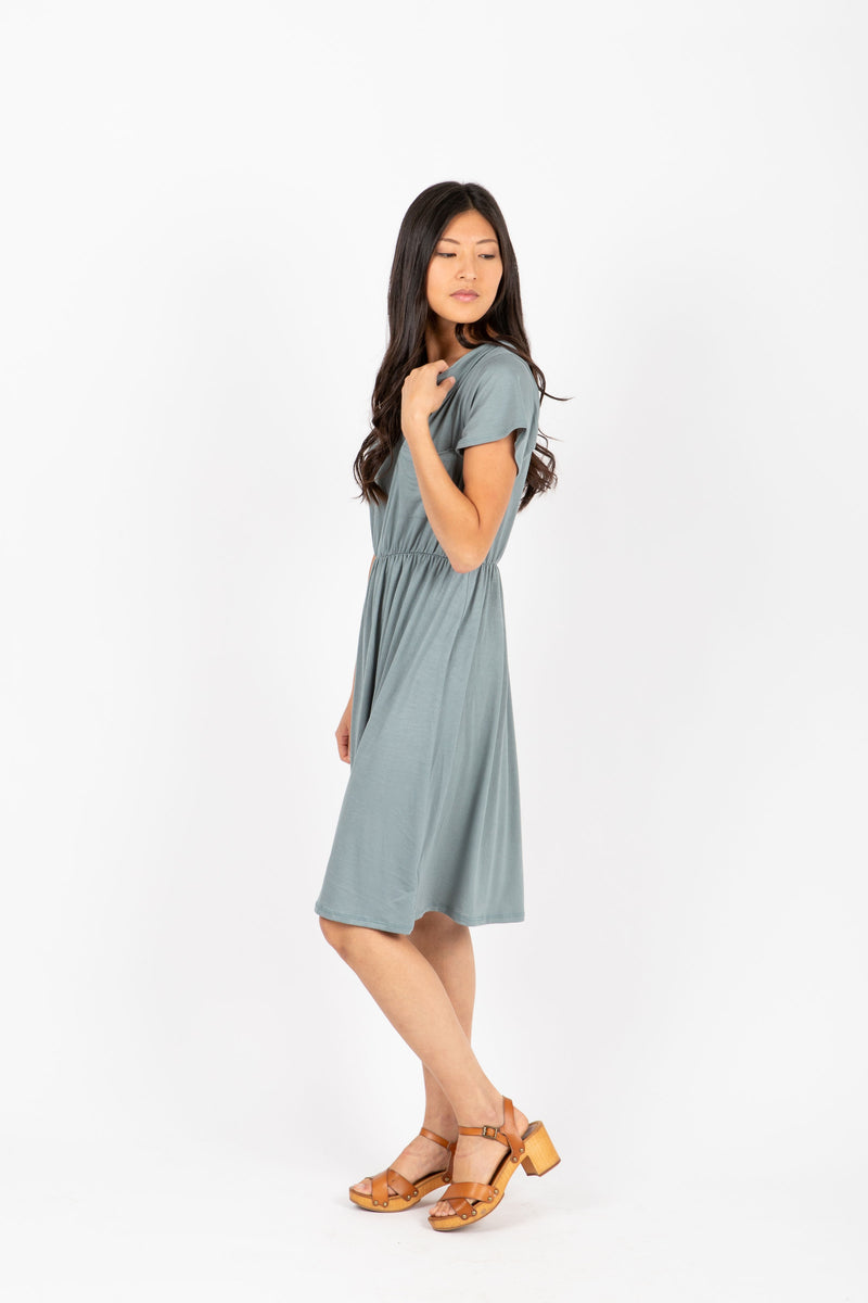 The Madeleine Casual Empire Dress in Sage- studio shoot; side view