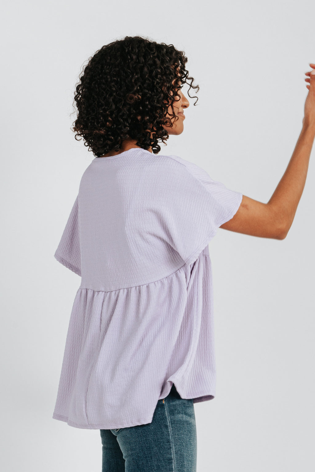 The Jolene Waffle Knit Peplum Blouse in Lavender, studio shoot; side view