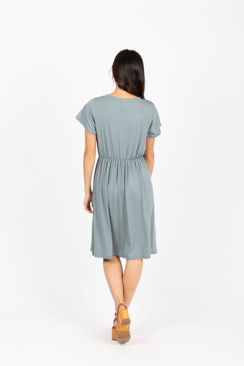 The Madeleine Casual Empire Dress in Sage- studio shoot; back view