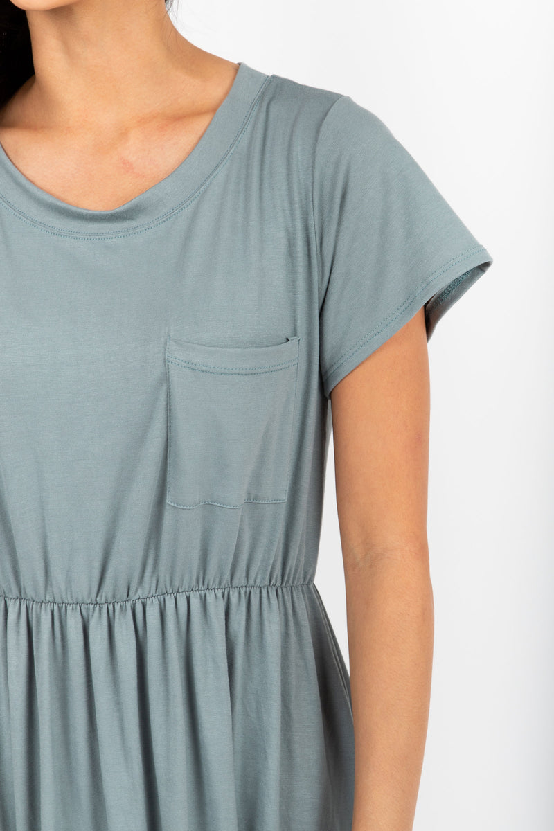 The Madeleine Casual Empire Dress in Sage- studio shoot; close up of arm front shot