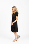 The Madeleine Casual Empire Dress in Black- studio shot; side view