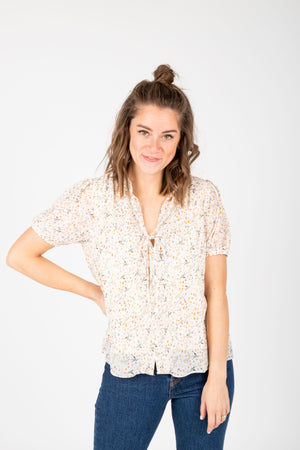 The Naya Floral Button Blouse in Ivory, studio shoot; front view