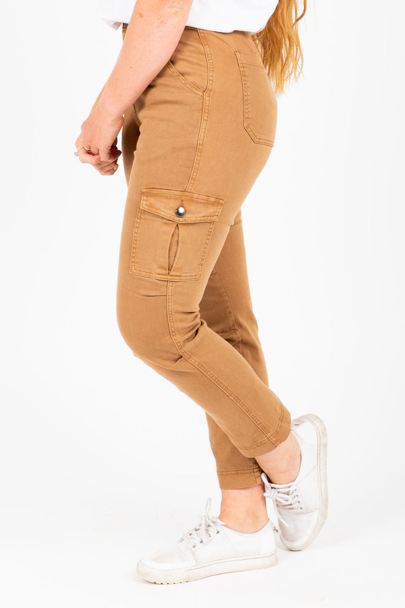The Edward Skinny Cargo Pants in Camel, studio shoot; side view