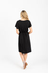 The Madeleine Casual Empire Dress in Black- studio shot; back view