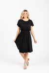 The Madeleine Casual Empire Dress in Black- studio shot; front view