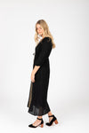 Piper & Scoot: The Cleo Beaded Detail Dress in Black, studio shoot; side view