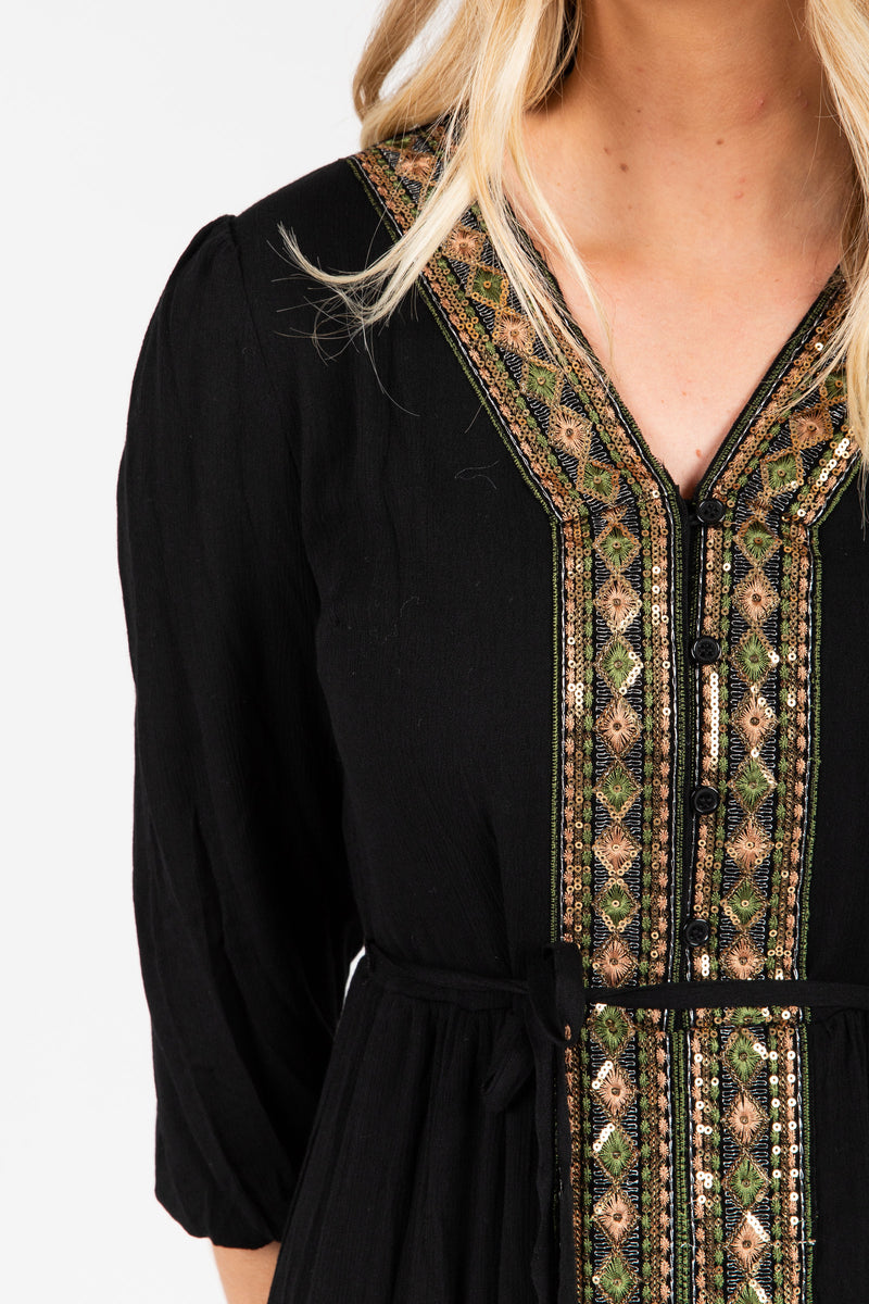 Piper & Scoot: The Cleo Beaded Detail Dress in Black, studio shoot; close up front view
