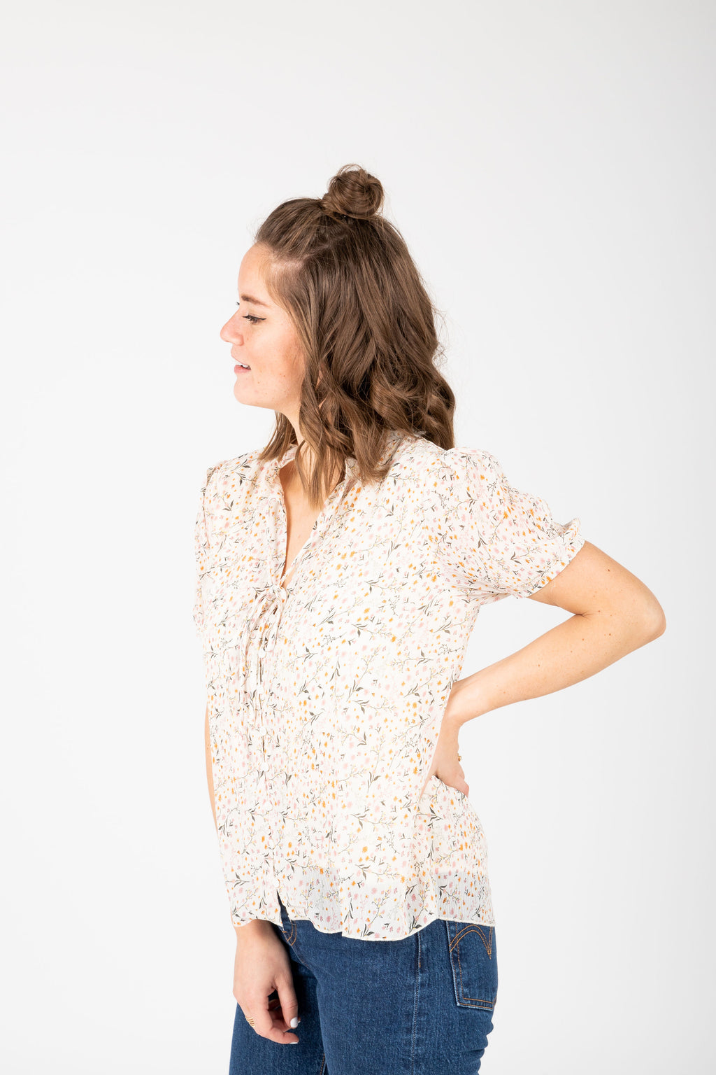 The Naya Floral Button Blouse in Ivory, studio shoot; side view
