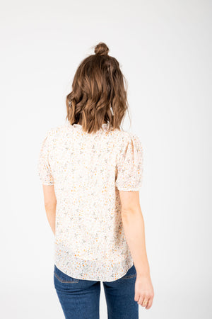 The Naya Floral Button Blouse in Ivory, studio shoot; back view