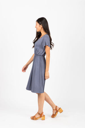 The Madeleine Casual Empire Dress in Shadow- studio shoot; side view